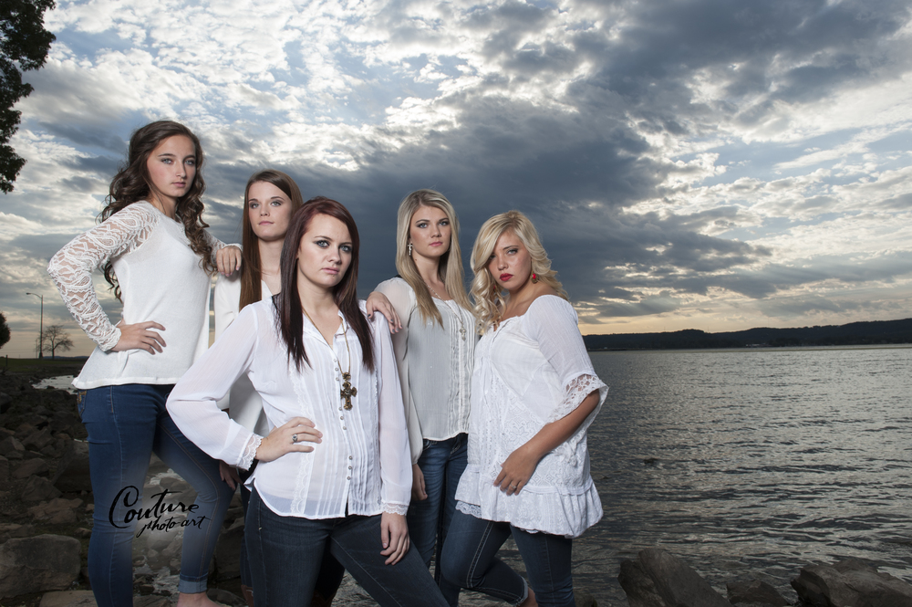 "The ladies show their intense ""supermodel side"" in this photo, which uses a mixture of natural light and studio lighting to feature a very beautiful and dramatic sky behind them."