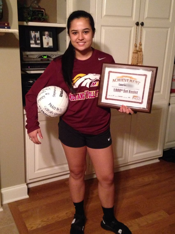 Lauren wins award for her 1,000th set assist for the Madison Academy Mustangs.