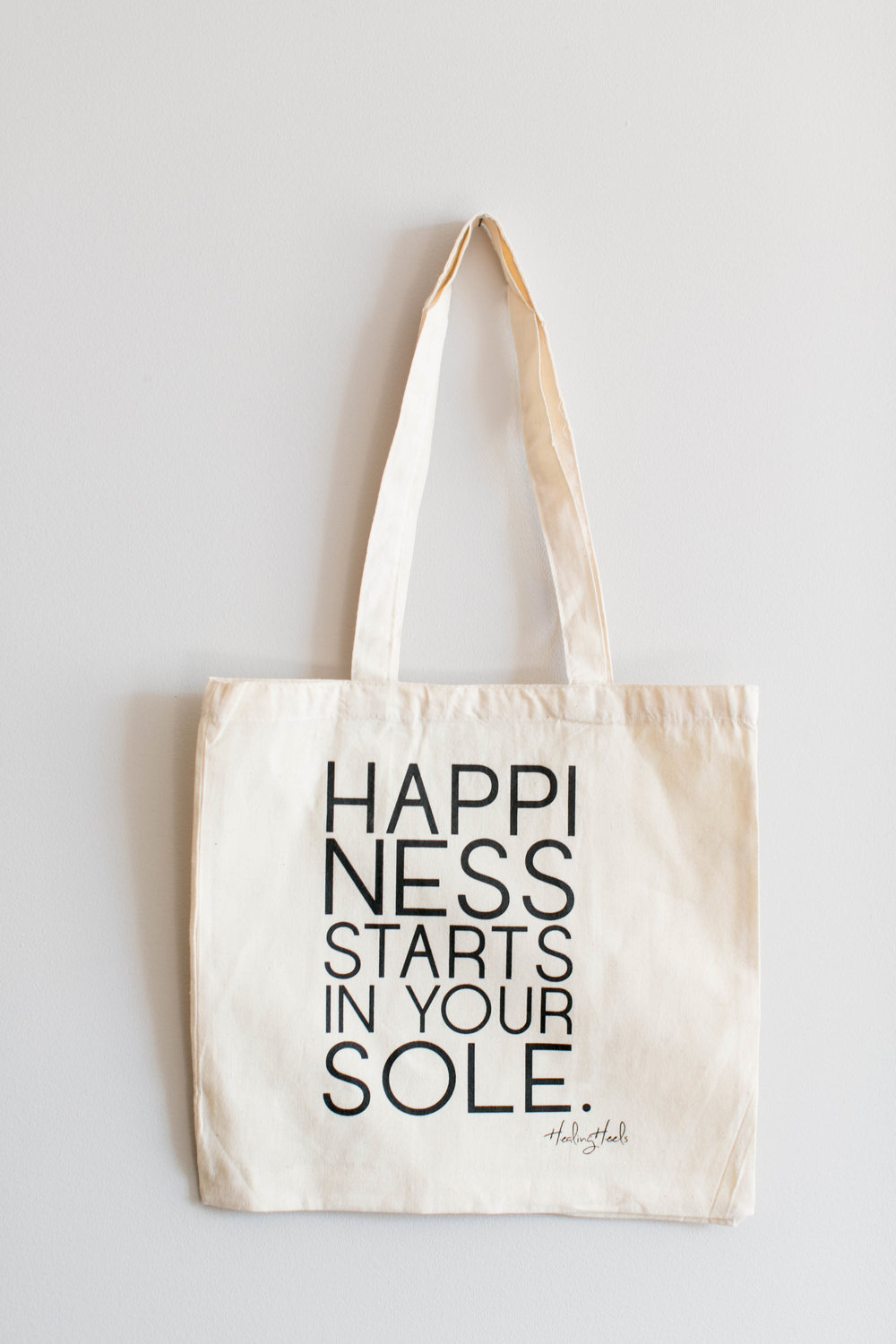 The Healing Heels 'Happiness Tote ' - Each purchase helps gift a pair of Healing Heels to a woman in cancer treatment.