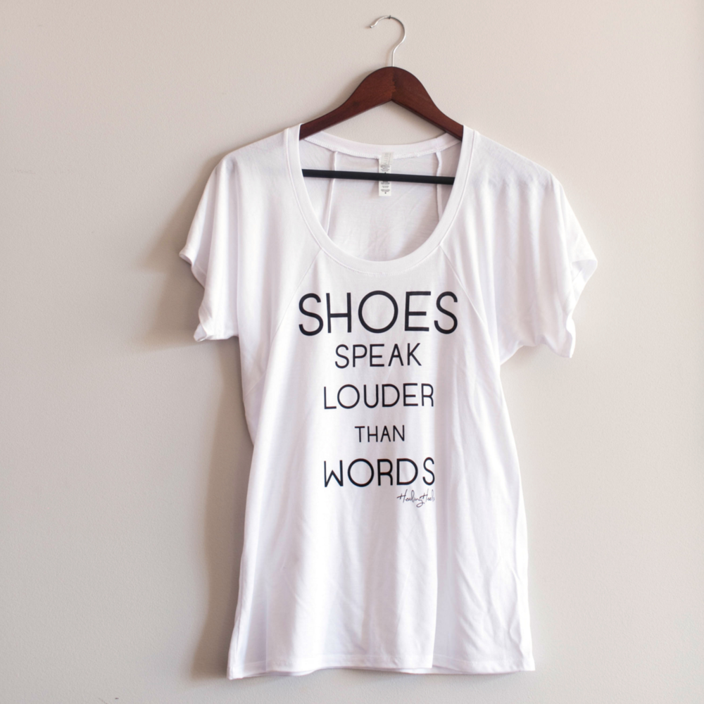Healing Heels 'Shoes Speak Louder than Words' Tee  - Your purchase helps gift a pair of Healing Heels to a woman fighting cancer.