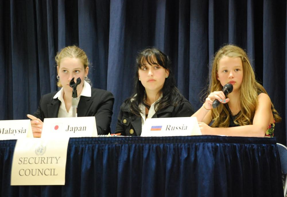 Representatives in the Security Council from Malaysia (Josie Ertl), Japan (Yvonne DiGirolamo), and Russia (Delaney Horner) answer questions posed to them by the press.