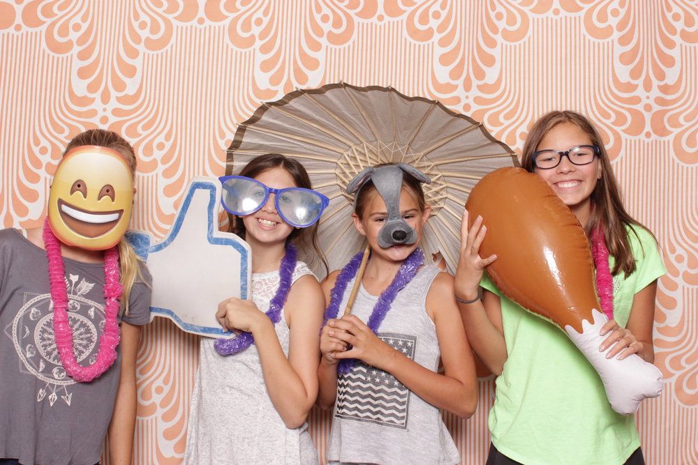 Infinite-hawaiian-luau-party-photo-booth-rental-chico-happy-emoji-mask