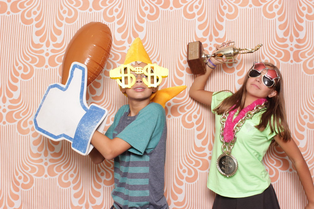 Infinite-hawaiian-luau-party-photo-booth-rental-chico-winners-thumbs-up