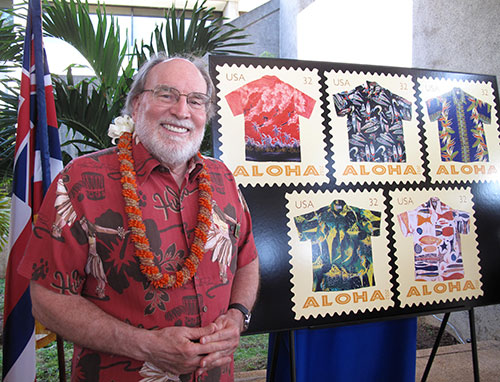 Governor Neil Abercrombie with the US Postal Service commemorative Aloha Shirt stamps.