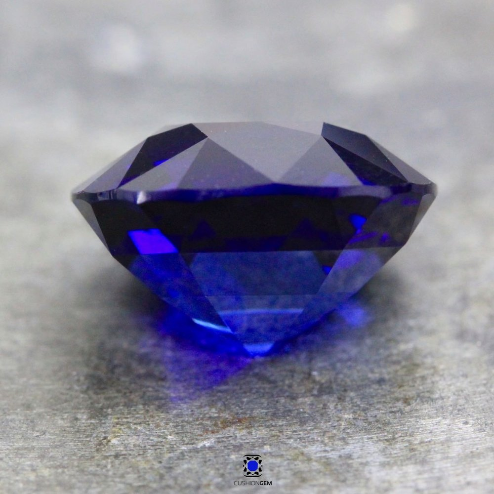 9.89cushionsapphire616.jpg