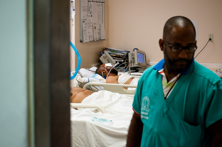 A nurse leaves the ICU room at the Hospital Traumatologico Dr. Ney Arias Lora, a large national hospital specializing in trauma, in Santo Domingo, Dominican Republic on July 2, 2014. Photo: Art Zaratsyan