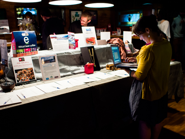 Michelle Langlois, program manager at HOPE International Development Agency, oversees the silent auction to benefit children orphaned by AIDS in Ethiopia, at The Blarney Stone Pub, Vancouver, BC, Canada on November 3, 2013.
