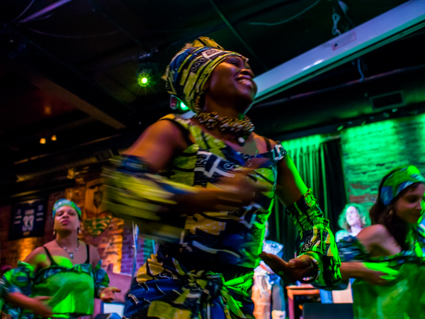 Jacky Essombe and her dance group performs a traditional African dance during HOPE International Development Agency fundraising event to benefit children orphaned by AIDS in Ethiopia, held at The Blarney Stone Pub, Vancouver, BC, Canada on November 3, 2013.