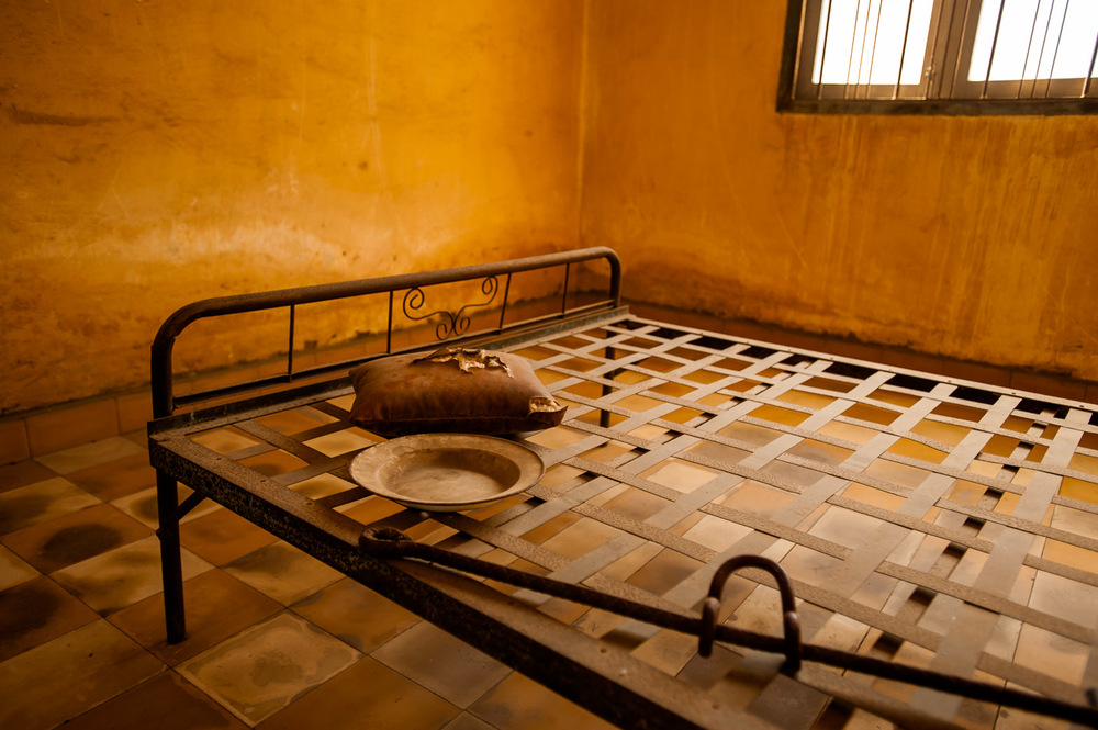 "A torture bed used to obtain ""confessions"" by Khmer Rouge from prisoners in one of many rooms in  S-21 prison. Tuol Sleng Genocide Museum in Phnom Penh, Cambodia, on December 6, 2013.  Copyright © 2013 Art Zaratsyan"