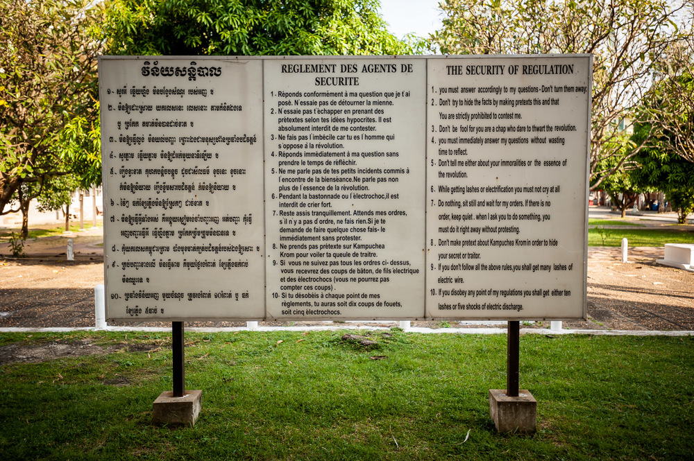 """While getting lashes or electrification you must not cry at all"" says the welcome sign with the rules of conduct at Tuol Sleng Genocide Museum, former high school repurposed as a Khmer Rouge S-21 prison in Phnom Penh, Cambodia, on December 6, 2013.  Copyright © 2013 Art Zaratsyan"
