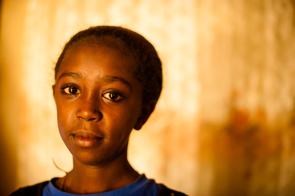 Hiwot Workneh tells me she wants to become a doctor when she grows up. Hiwot is a 12 year old HIV-positive girl in the care of Save Lives Ethiopia (SaLE) organization supported by HOPE International Development Agency. Save Lives Ethiopia supports orphans of AIDS in the slums of Addis Ababa, Ethiopia. January 28, 2014.  Copyright © 2014 Art Zaratsyan