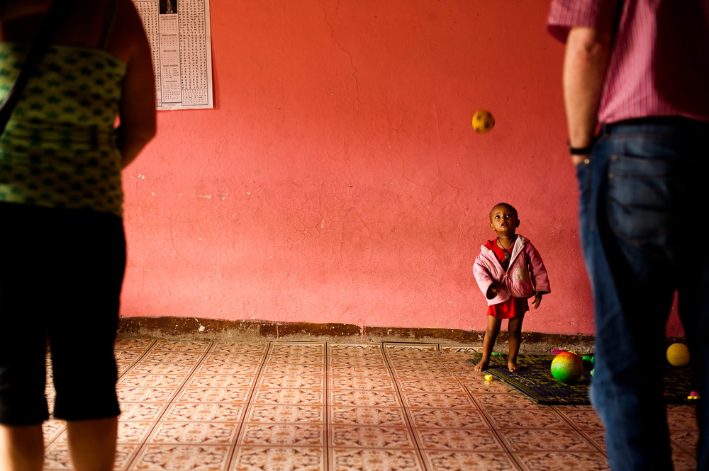 A boy plays with his ball in the Save Lives Ethiopia (SaLE) funded daycare for children of sex workers in the slums of Addis Abeba, Ethiopia, operated by a group of local women. Save Lives Ethiopia supports orphans of AIDS, and is one of the local humanitarian organizations supported by HOPE International Development Agency. January 28, 2014.  Copyright © 2014 Art Zaratsyan