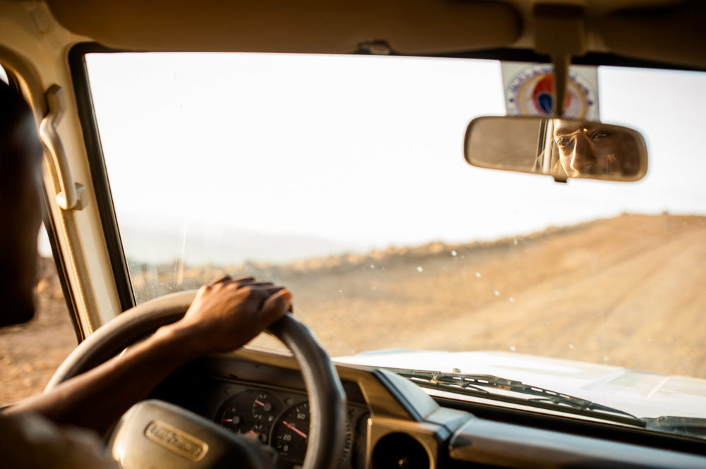 Melkamu, technician and mechanic at HOPE Ethiopia, drives back to Arba Minch after a long day spent working at development project sites in rural SNNPR, Ethiopia on January 31, 2014.  Copyright © 2014 Art Zaratsyan