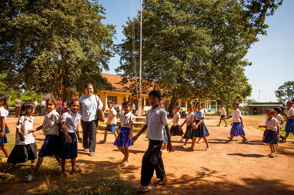 """Phealy """"Ly"""" Kim, head of HOPE International Development Agency, Cambodia, visits a rural primary school built by the organization in the Pursat, poorest province in the country. November 20, 2013.  Copyright © 2013 Art Zaratsyan"""