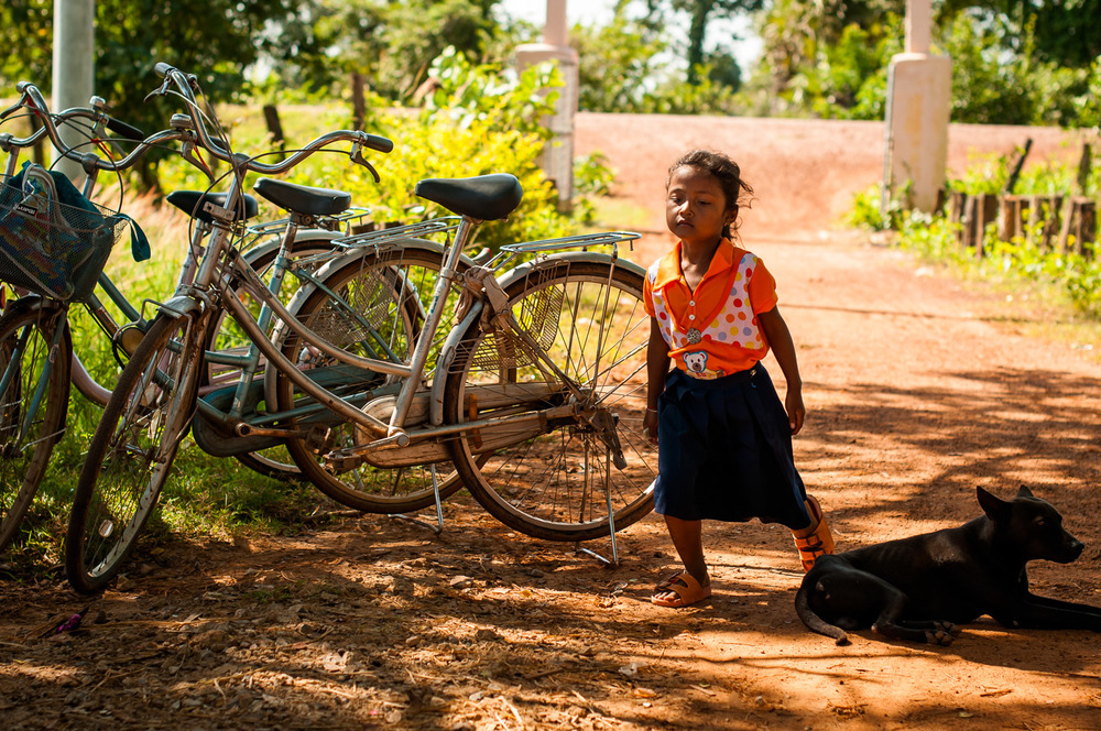 A little girl runs to school after recess. In the province of Pursat, Cambodia, on November 20, 2013.  Copyright © 2013 Art Zaratsyan