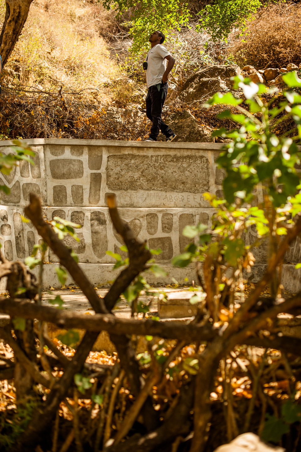 Wosen Girma, head of the Arba Minch branch of HOPE International Development Agency, inspects the capped source that provides the people of Koshale with clean water. Ethiopia on January 23, 2014.  Copyright © 2014 Art Zaratsyan