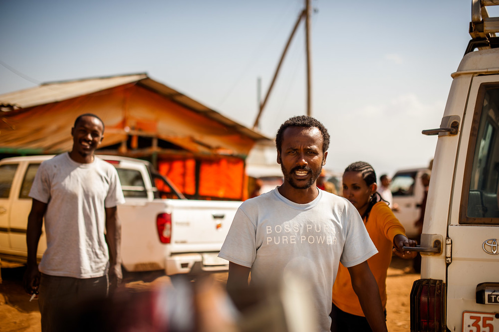 Melkamu and Fetene, water engineer at HOPE International Development Agency Arba Minch branch, make a coffee stop in Geresse. Ethiopia on January 23, 2014.  Copyright © 2014 Art Zaratsyan