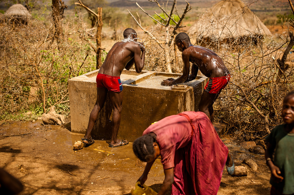 Men wash at a clean water basin in the village of Koshale, Ethiopia on February 1, 2014.  Copyright © 2014 Art Zaratsyan
