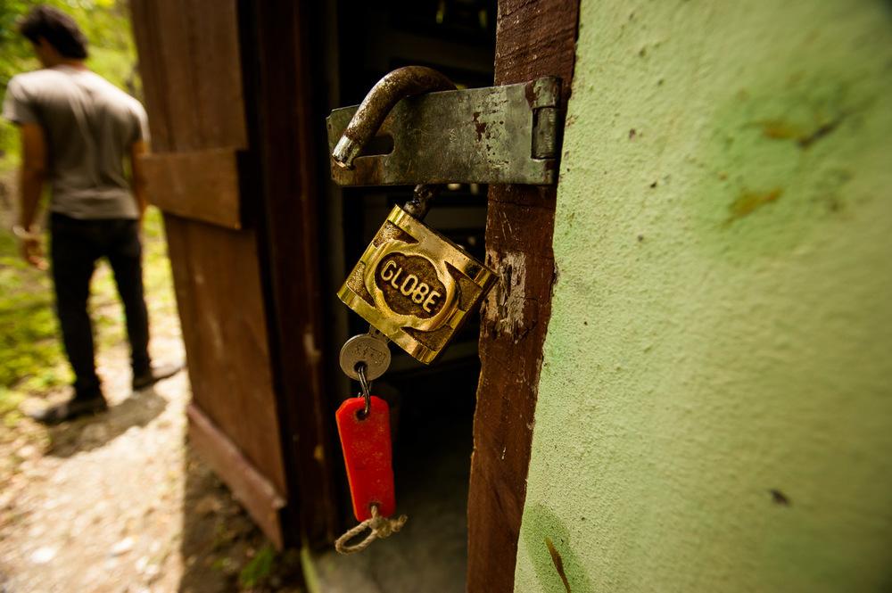 This simple padlock secures the access to the hydro turbine powering Los Martinez, San José De Ocoa. July 4, 2014.  Copyright © 2014 Art Zaratsyan