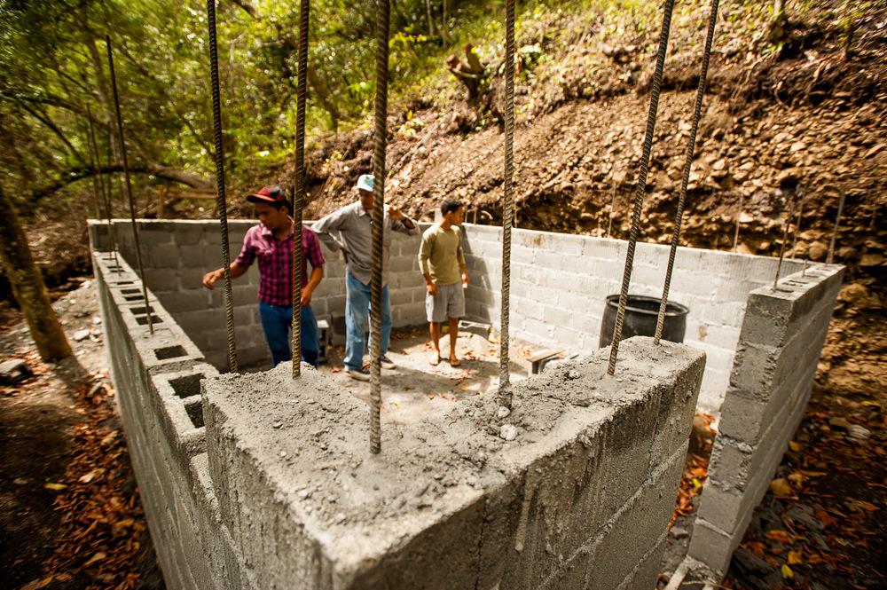 Manuel Pinales and Carlos Bonilla, head of Natural Resources at ADESJO, discuss the construction of a new hydro micro-plant to power the community of Las Avispas, San José De Ocoa, Dominican Republic. July 10, 2014.  Copyright © 2014 Art Zaratsyan