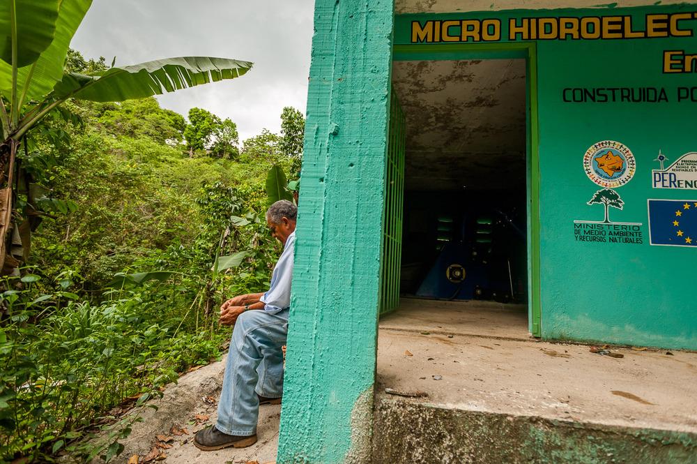 Carlos Bonilla of ADESJO takes a short break before leaving the hydro power micro-plant in La Bocaina, San José De Ocoa, Dominican Republic. July 3, 2014.  Copyright © 2014 Art Zaratsyan
