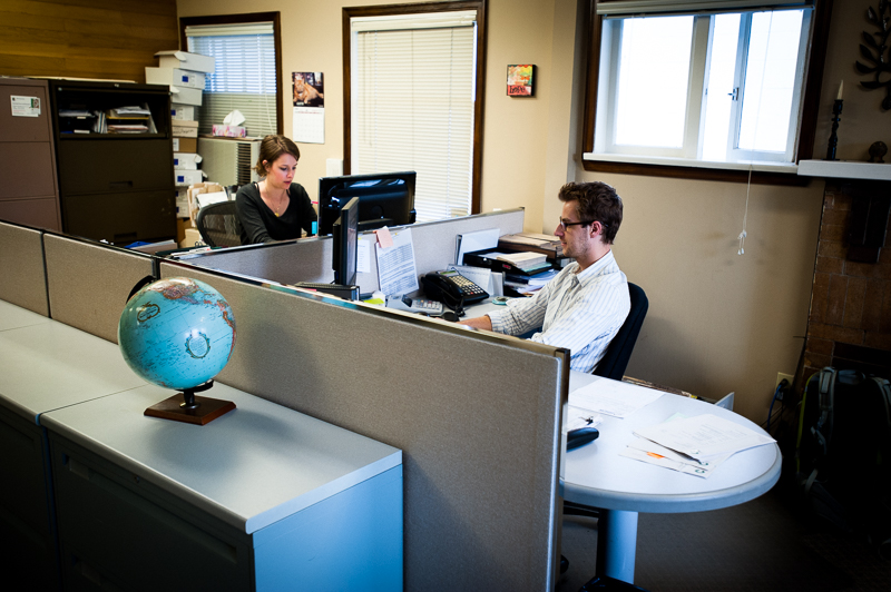 Kaitlin Takaoka, a student helping HOPE for the summer, and Luke Scoates, accounting administrator, are hard at work at HOPE International Development Agency headquarters, New Westminster, BC, Canada on August-15-2013. Photo: Art Zaratsyan