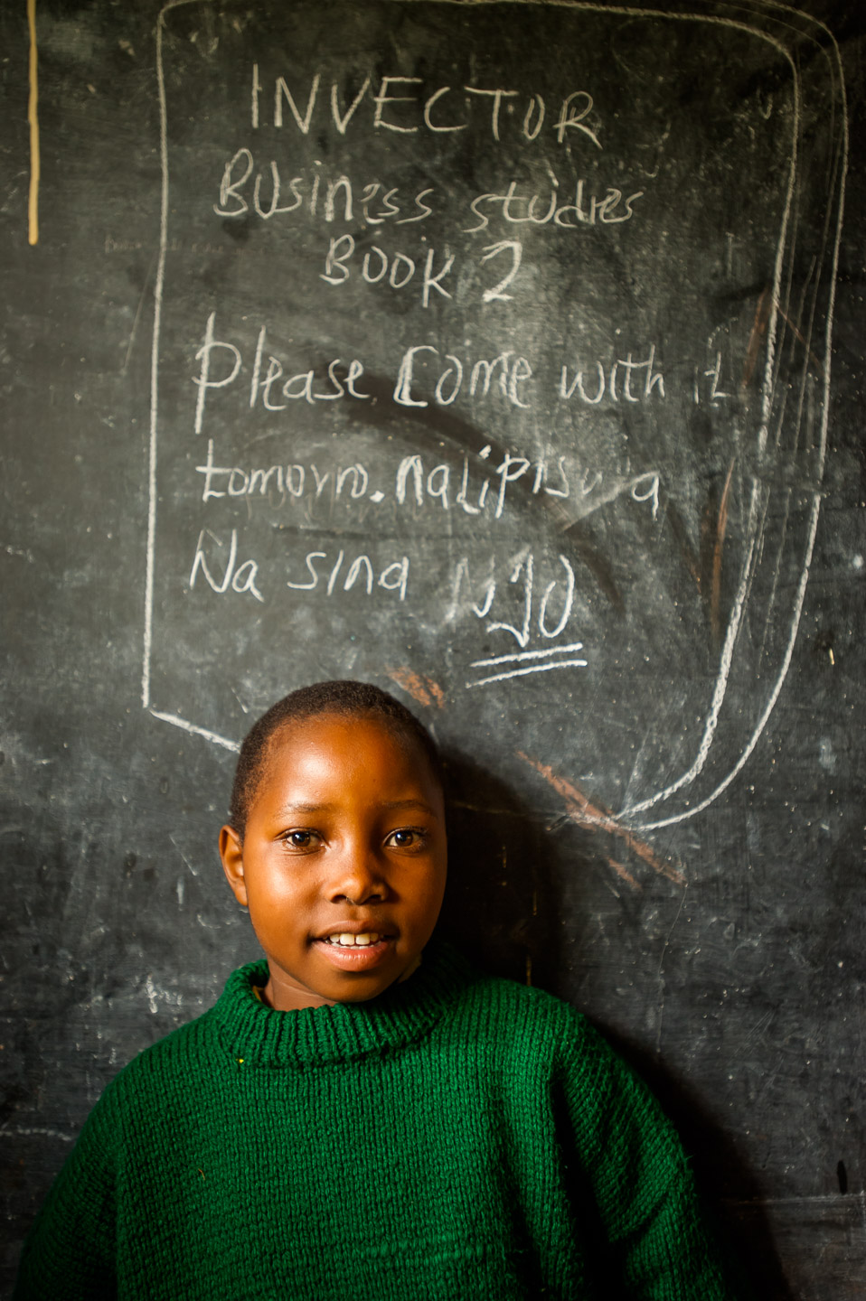 Students of the secondary school in Mucagara, Kenya, site of a library donated by Elimu Impact Evaluation Centre. December 10, 2014. Photo: Art Zaratsyan for Photographers Without Borders