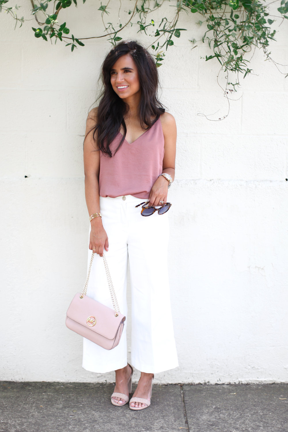 I HAVE THIS CAMI IN EVERY COLOR! IT'S A SUMMER MUST HAVE! - TOP : EXPRESS (SHOP HERE) PANTS : ANN TAYLOR (SHOP HERE) SHOES : STEVE MADDEN (SHOP HERE) HANDBAG : MICHAEL KORS (SIMILAR HERE) SUNNIES : KAREN WALKER (SHOP HERE)