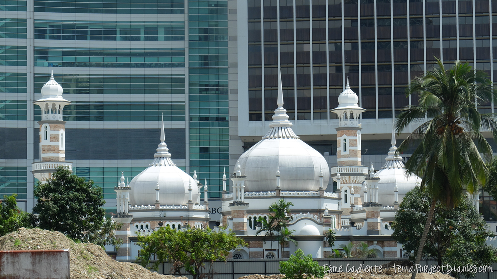 Mosques sit quietly in front of contemporary skyscrapers, Kuala Lumpur
