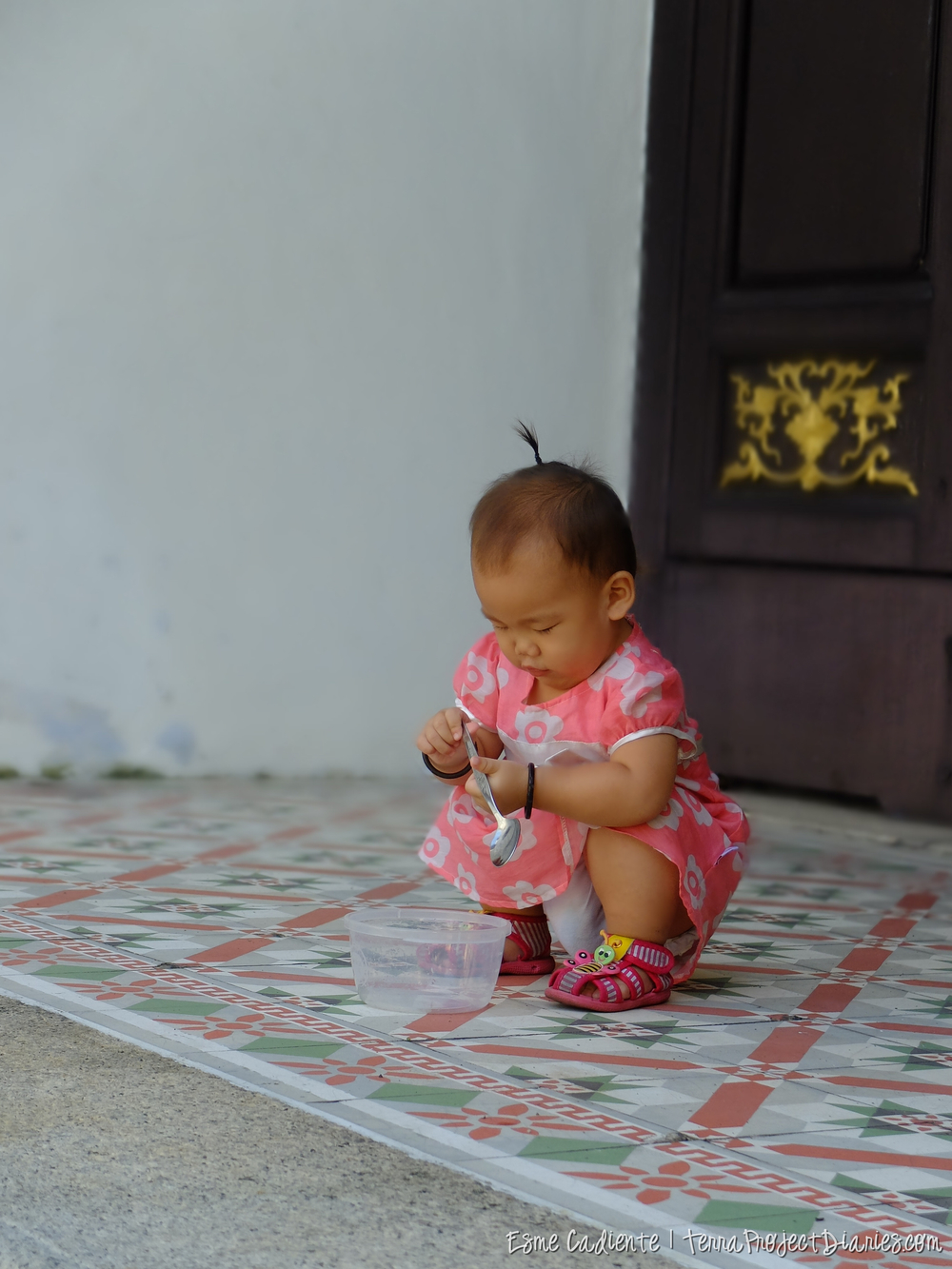 Chinese baby playing in a temple