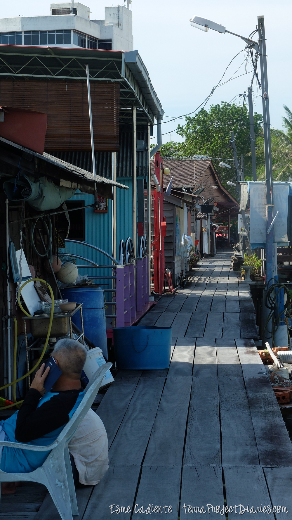 A man outside his home, floating villages, Penang