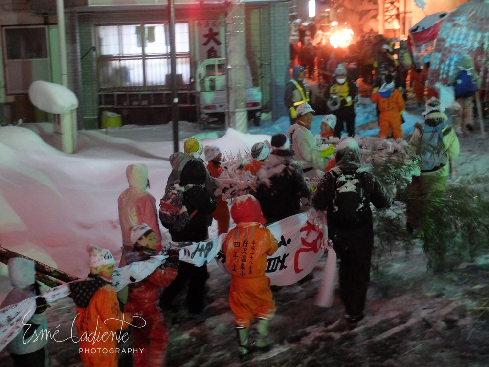 The Fire Festival begins with a parade that snakes through the streets of Nozawa Onsen.