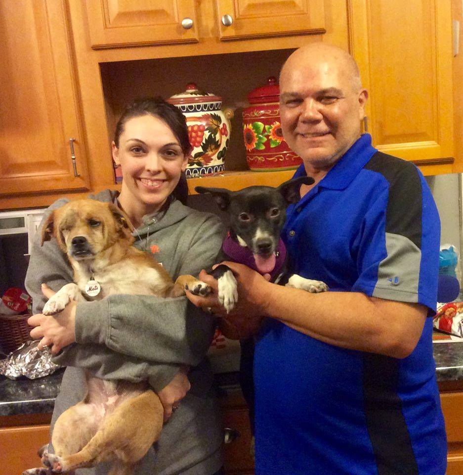 Alex's family with their adopted satos!