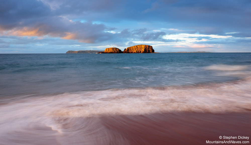 Golden light strikes Sheep Island, Ballintoy, at sunset - Northern Ireland landscape photography by Stephen Dickey.