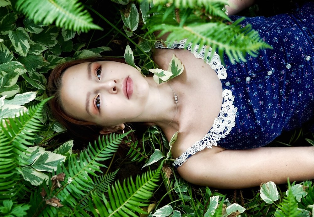 FACES: Alice lays in between the ferns, amidst her own wonderland - Portland, Oregon