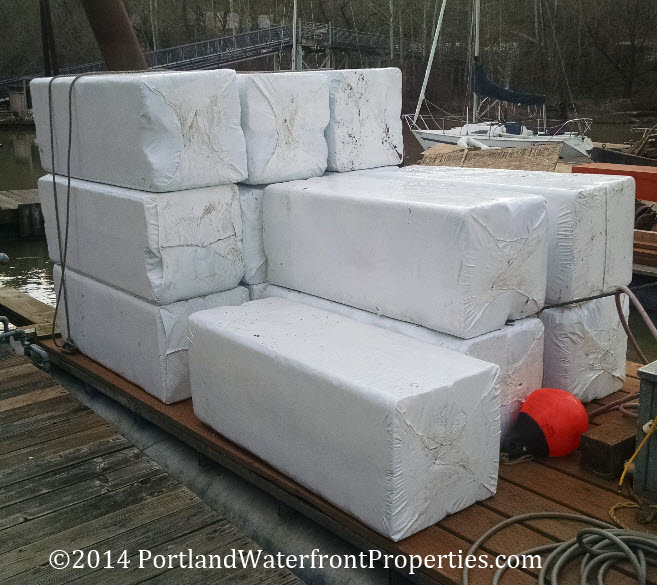 Floating home float construction the log float method for Foam block construction