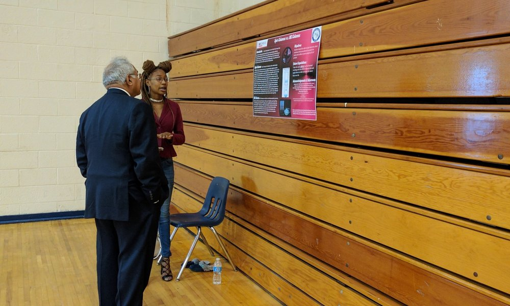Caiyah tells Dr. Qureshi about protein purification methods.