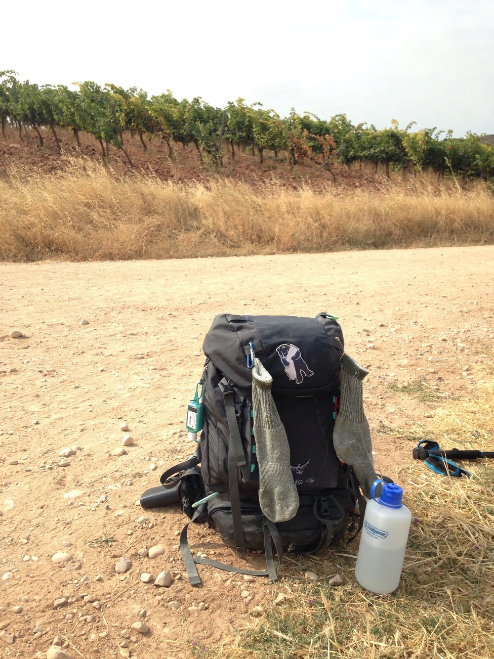 Drying socks and dirty backpack on the dusty road to los arcos