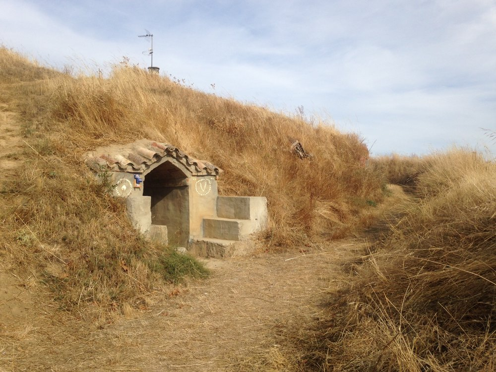 Not Hobbit Houses!, a sign helpfully explained to passing pilgrims.  These little cave cottages are for storing wine.