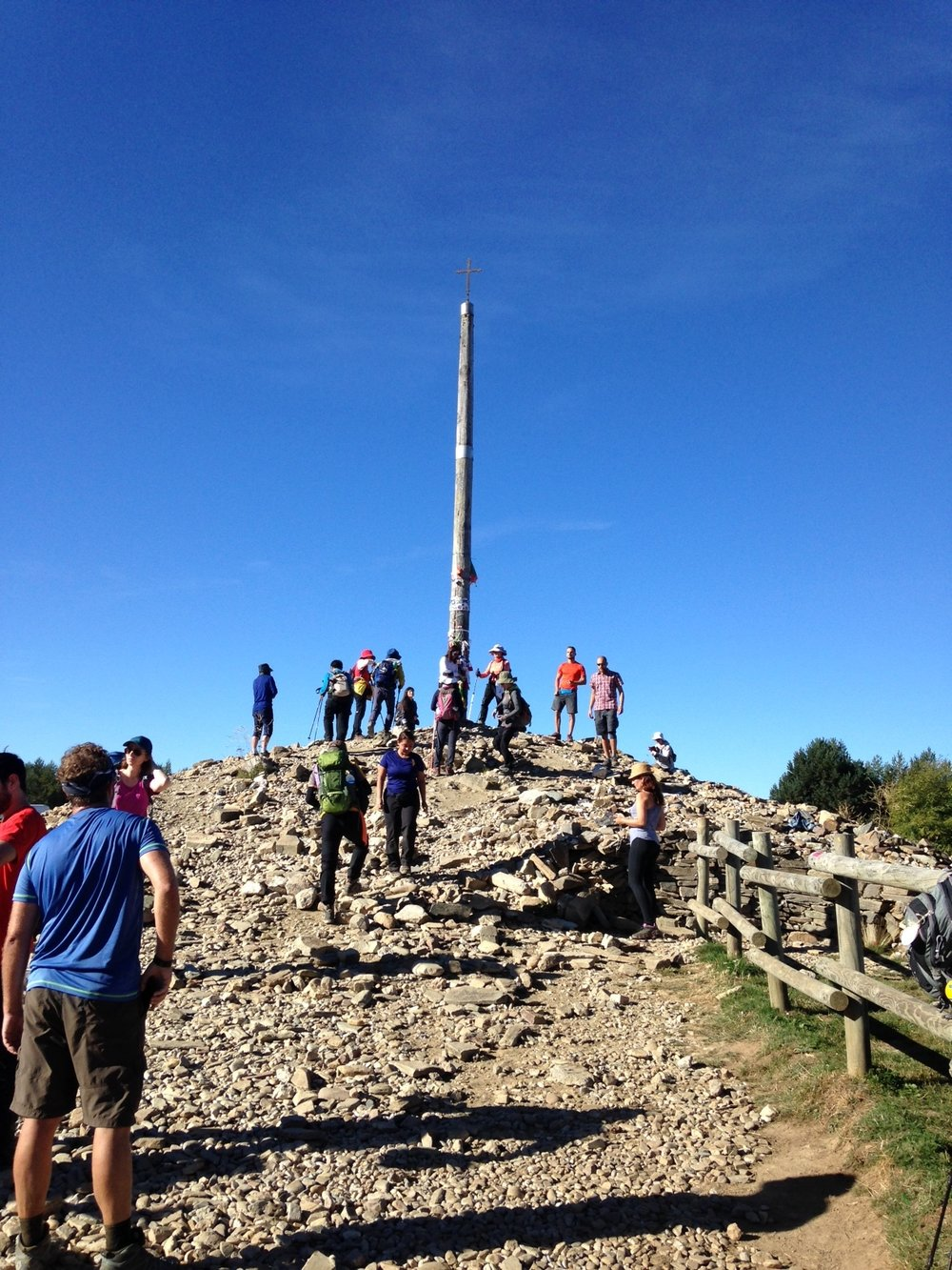 Cruz de Ferro where pilgrims leave a stone from home, also symbolically leaving behind a burden they have carried