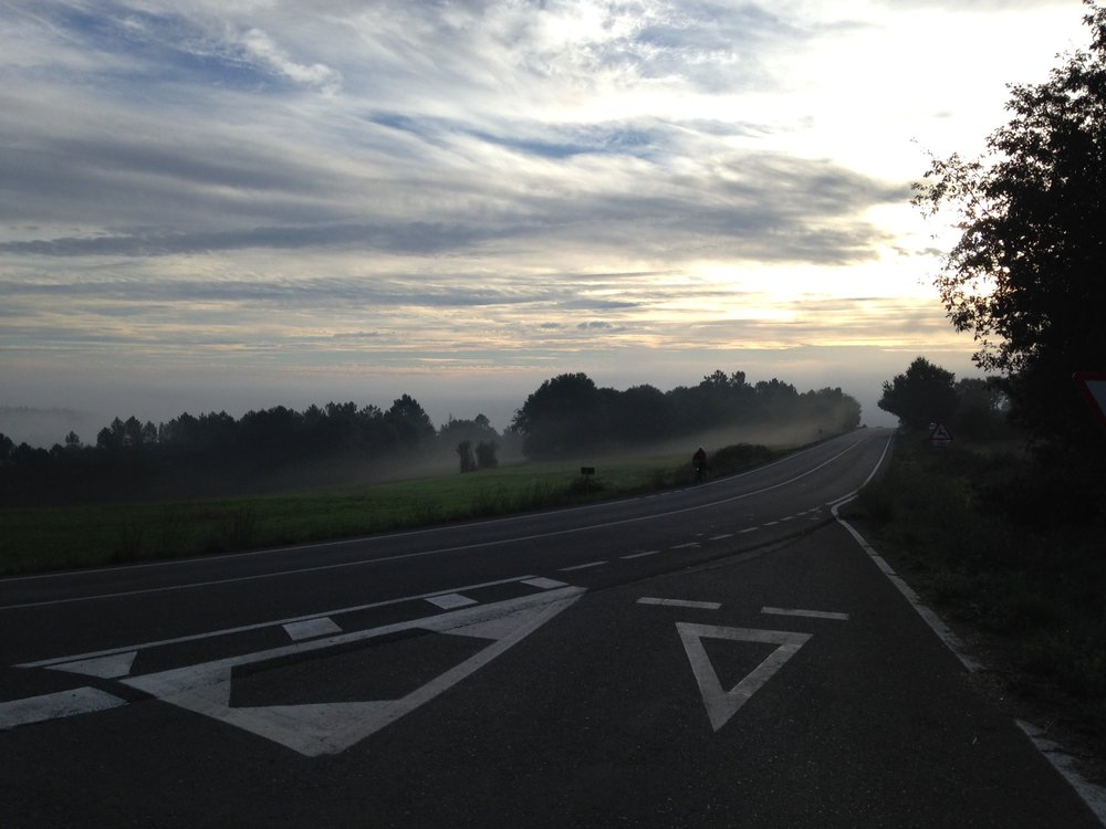 Big sky and empty roads leaving Portomarin in the early morning. This empty highway photo is deceptive--the road might be empty but the Camino is jam packed with pilgrims this morning!
