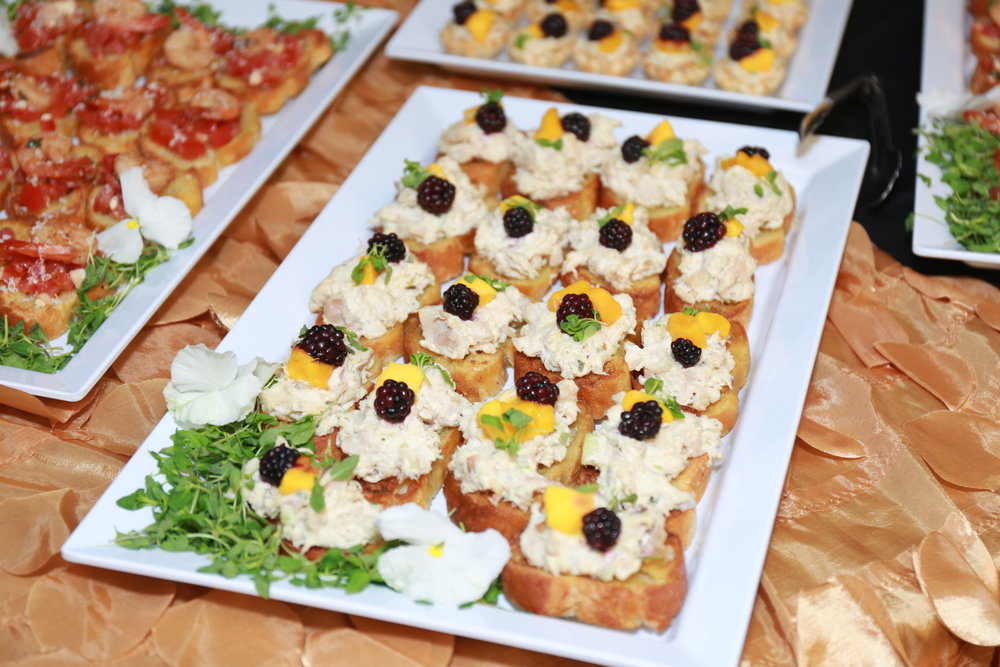 Chicken Salad Crostini topped with Mango and Blackberry