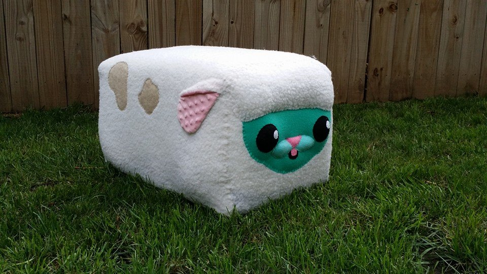 Custom plush ottoman by Alisa Ross.