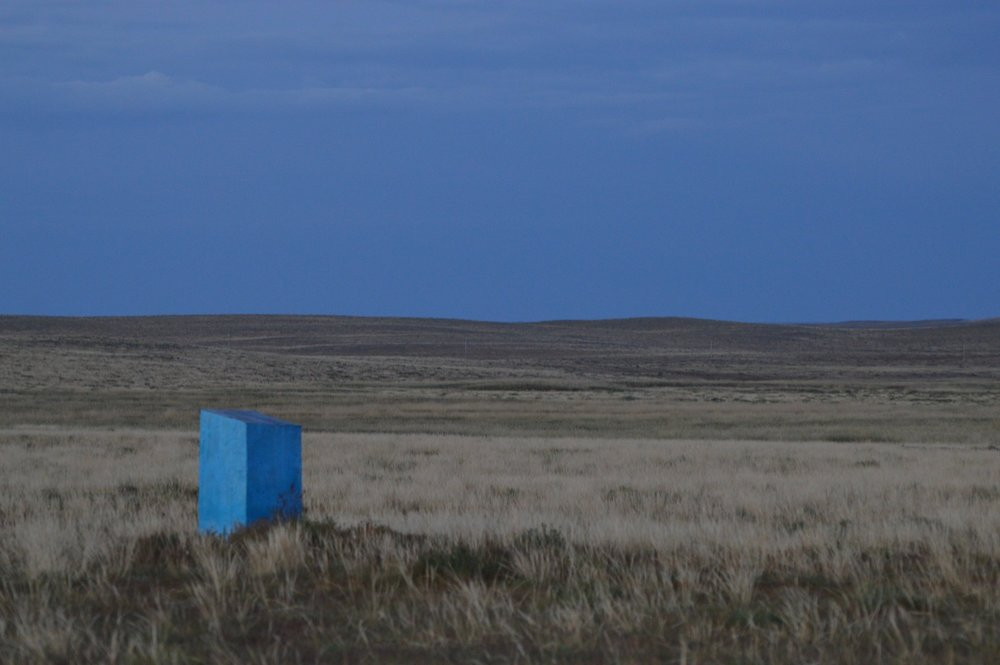 The outhouse matched the blue skies at sunset