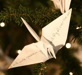 An origami crane with a wish on it on the RWF World Tree of Hope.
