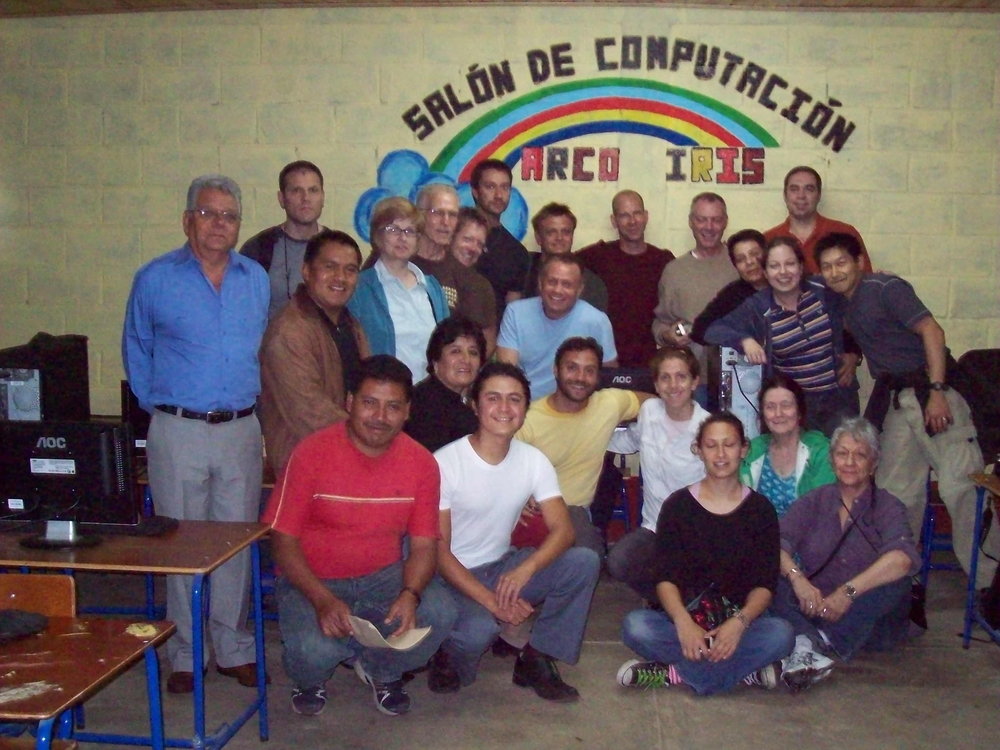 "Volunteers visit the ""Salon de Computacion Arco Iris"" Rainbow computer lab that RWF funded at a high school in the Quiché Department in rural Guatemala."