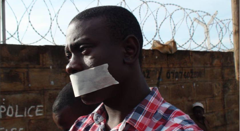 Richard Lusimbo protesting outside of a police office in Kampala, Uganda   (pic)