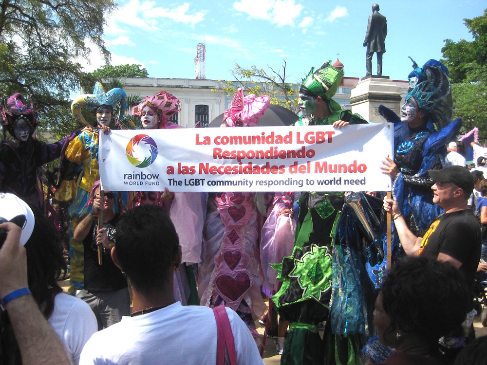 Rainbow World Fund volunteers hold a banner at the second city Jornada parade and celebration in Matanzas, Cuba (2015)