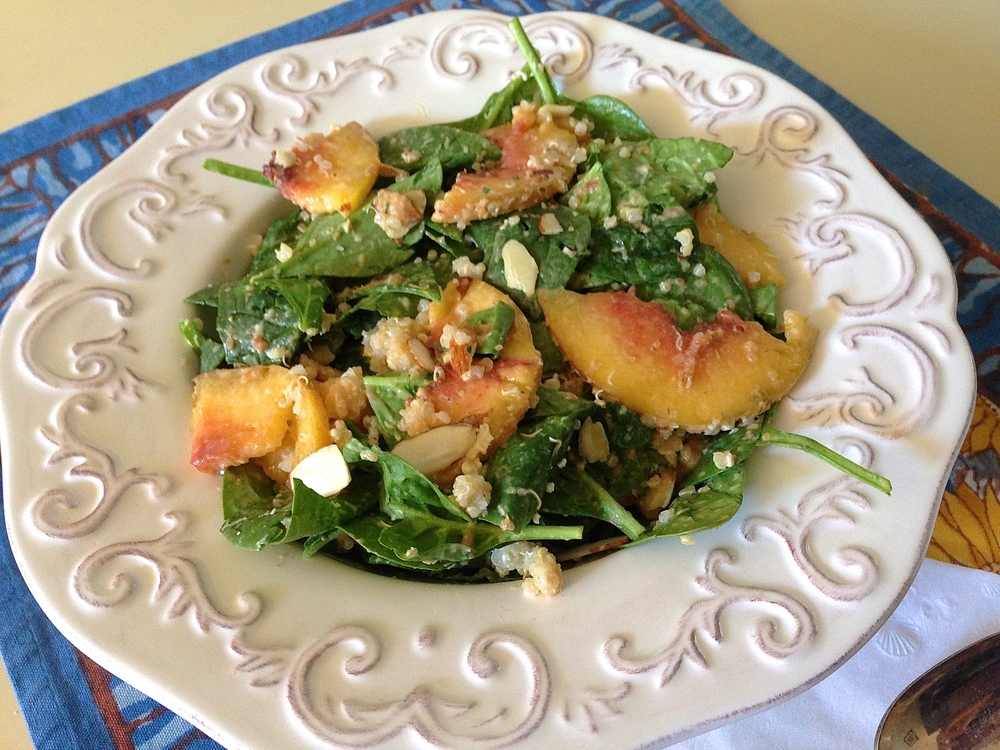 Spinach Peach Salad with Quinoa, Goat Cheese + Creamy Peach Vinaigrette | Kneading Home
