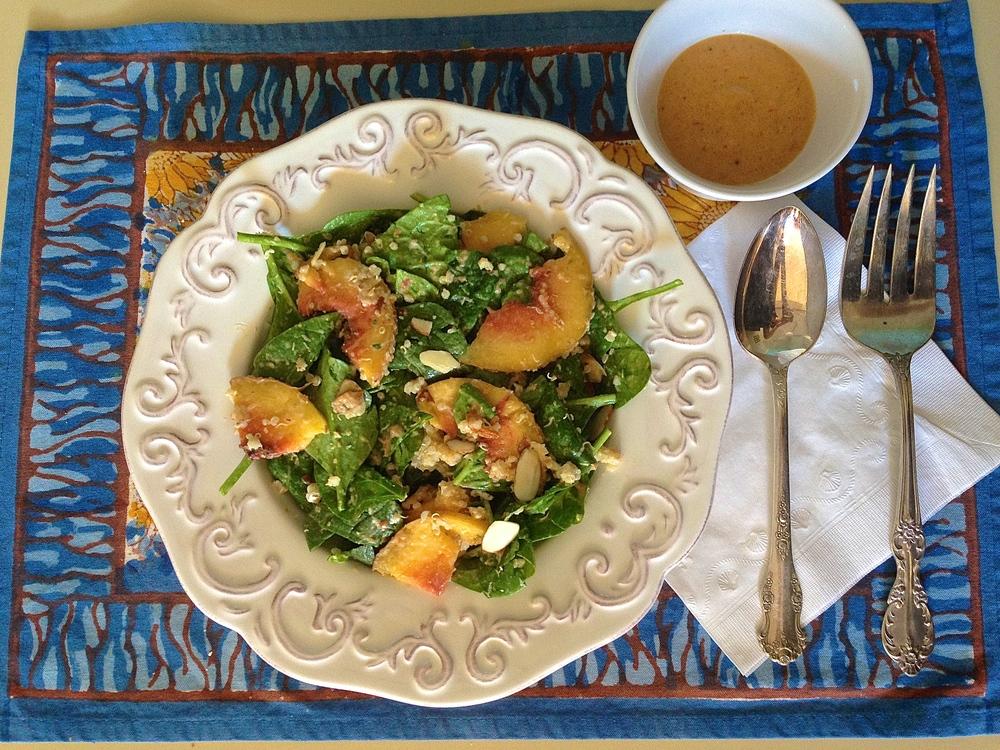 Spinach Peach Salad with Quinoa, Goat Cheese + Creamy Peach Vinaigrette | Kneading Home